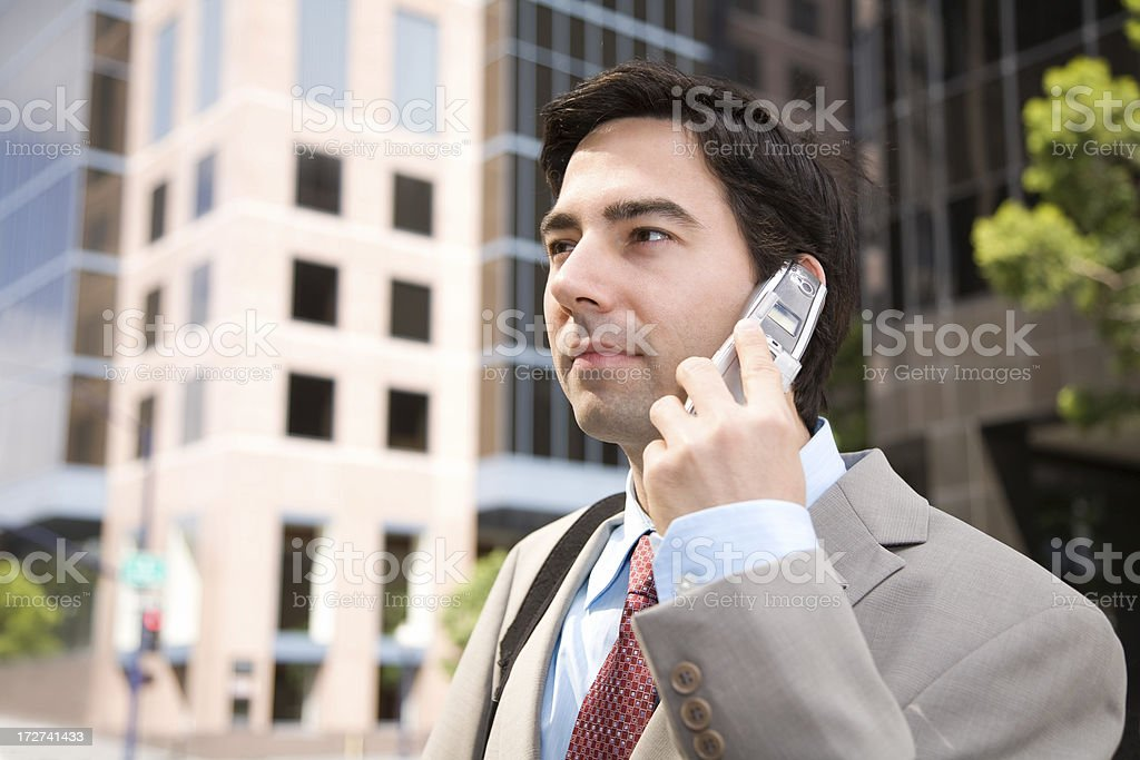 Businessman on Cellphone in the City stock photo