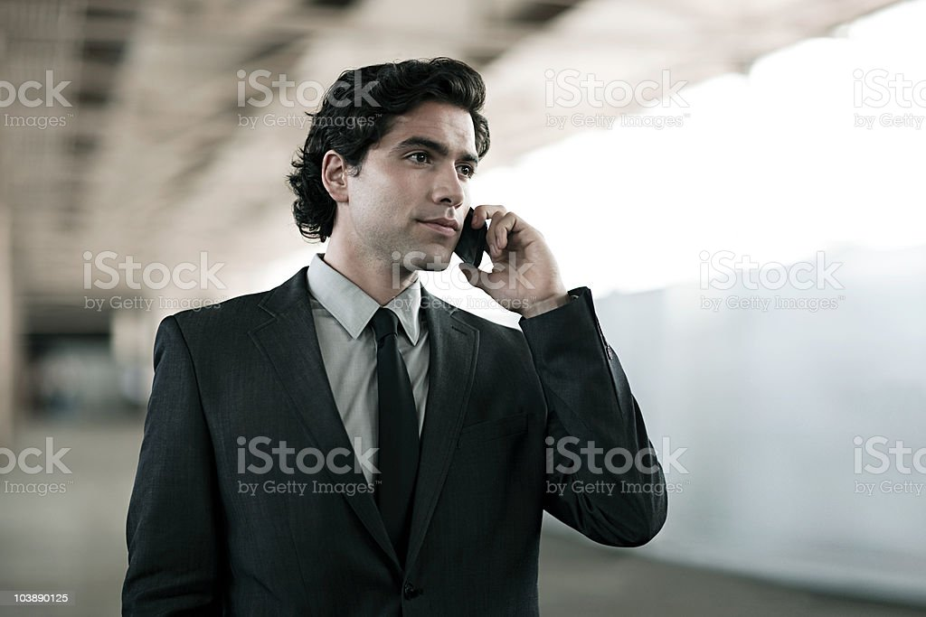 Businessman on cellphone stock photo