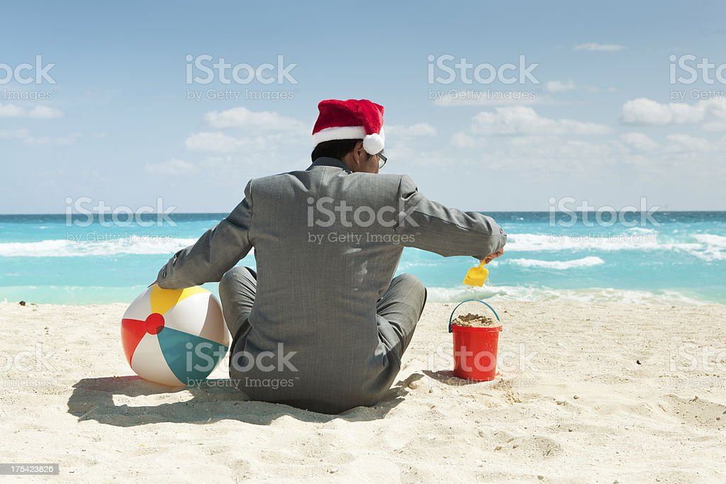 Businessman on Christmas Vacation in Tropical Beach Hz royalty-free stock photo