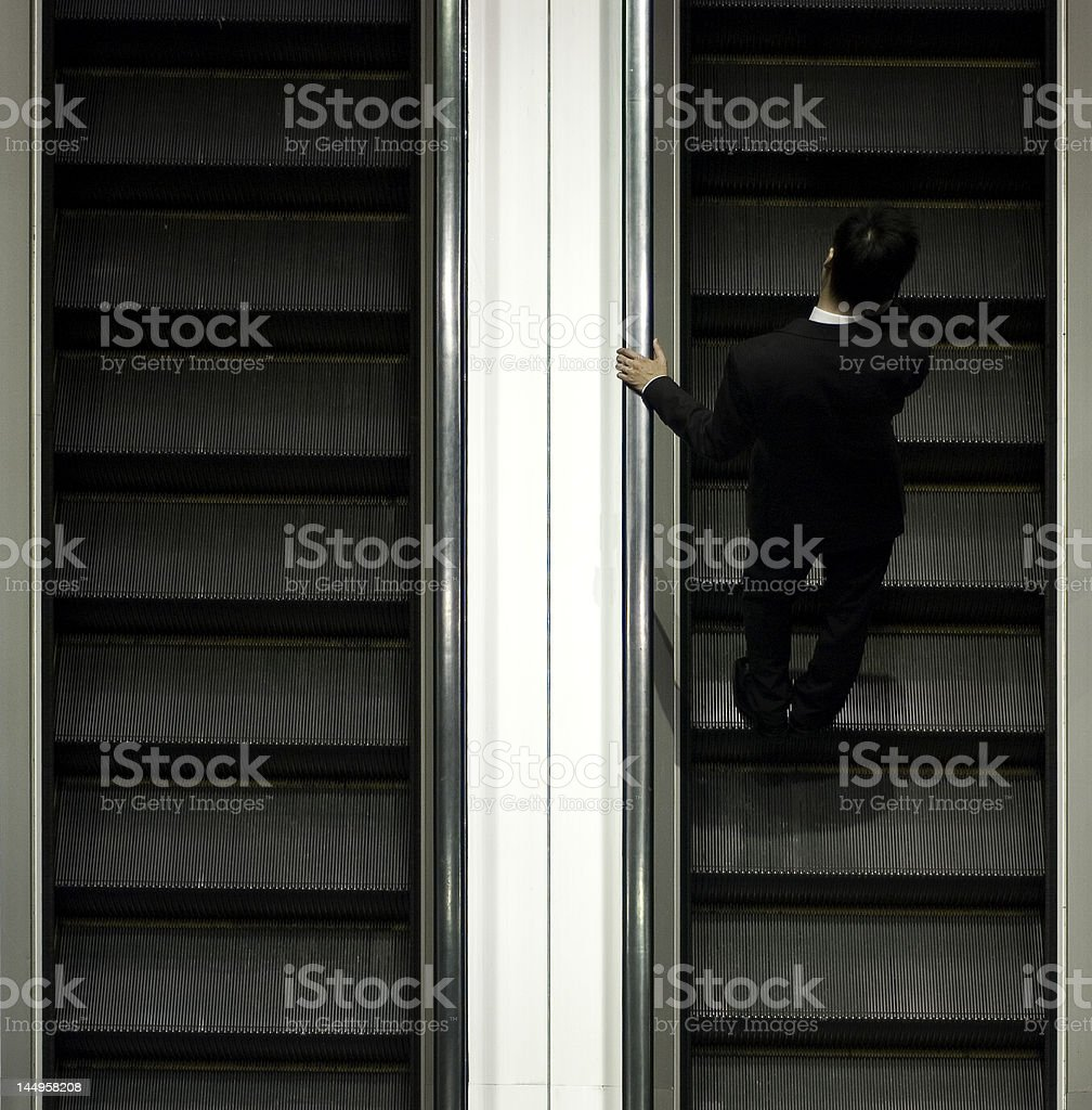 businessman on escalator royalty-free stock photo