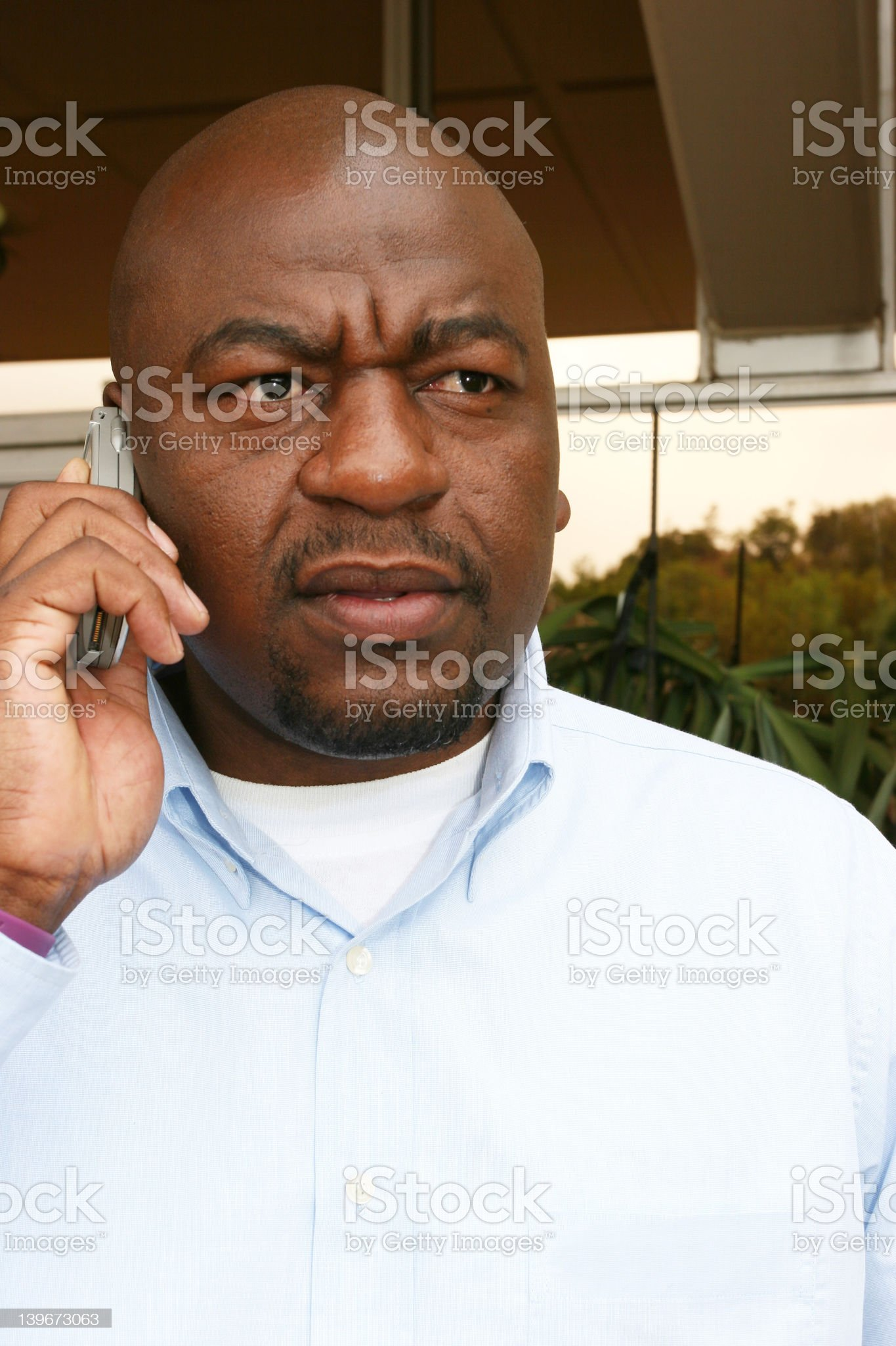Businessman on his phone royalty-free stock photo
