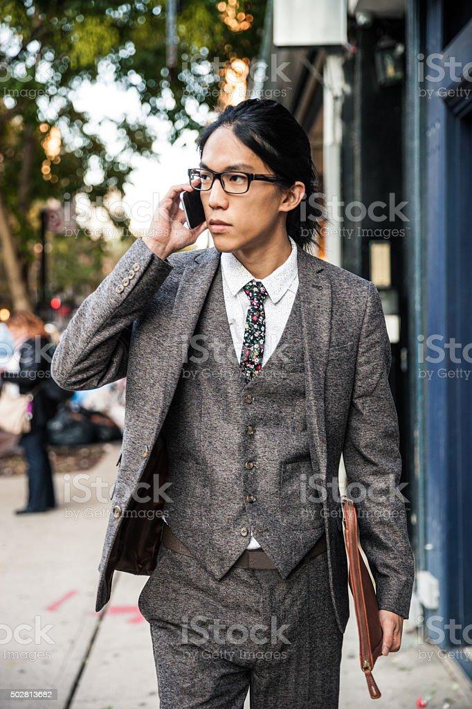 Businessman on mobile in Soho New York stock photo