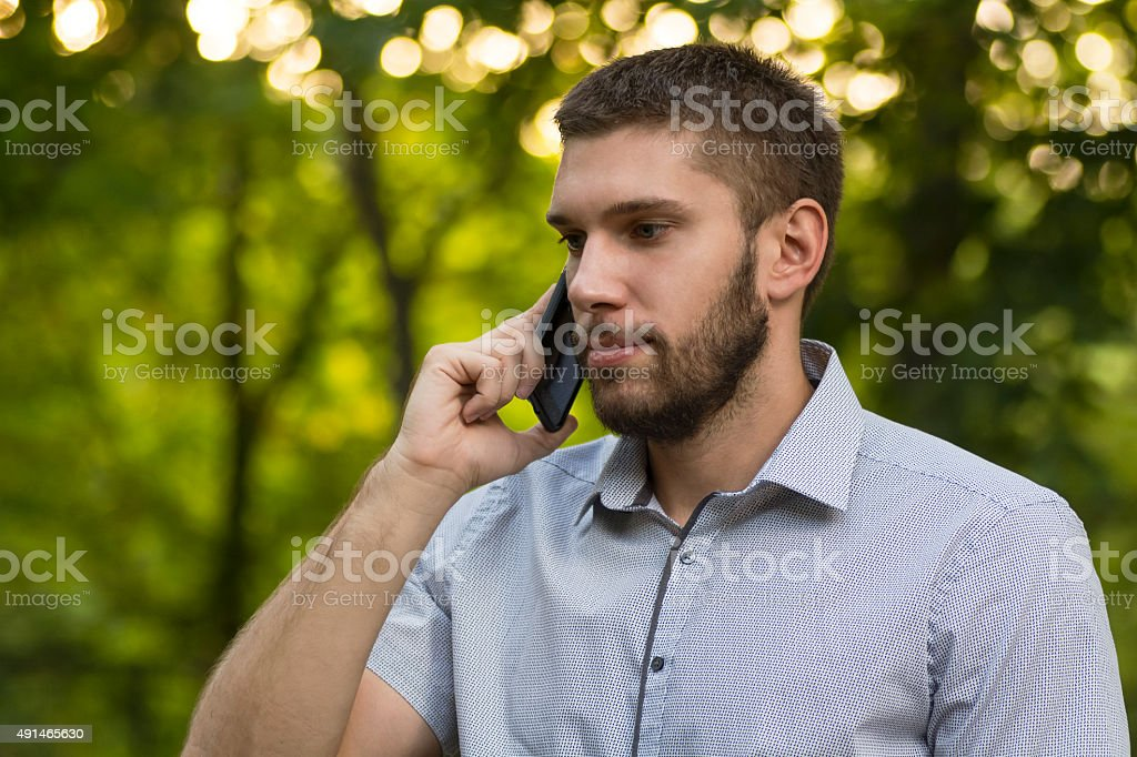 Businessman on mobile outdoor royalty-free stock photo