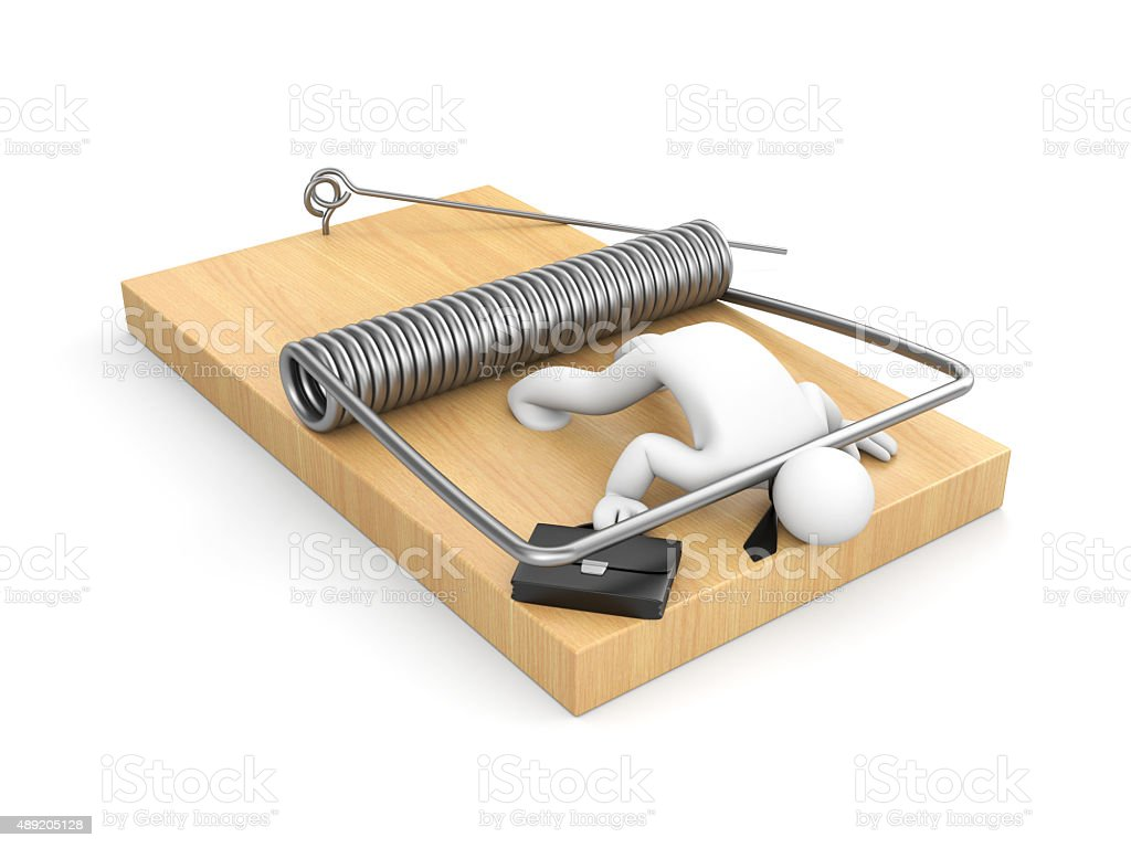 Businessman on mousetrap stock photo