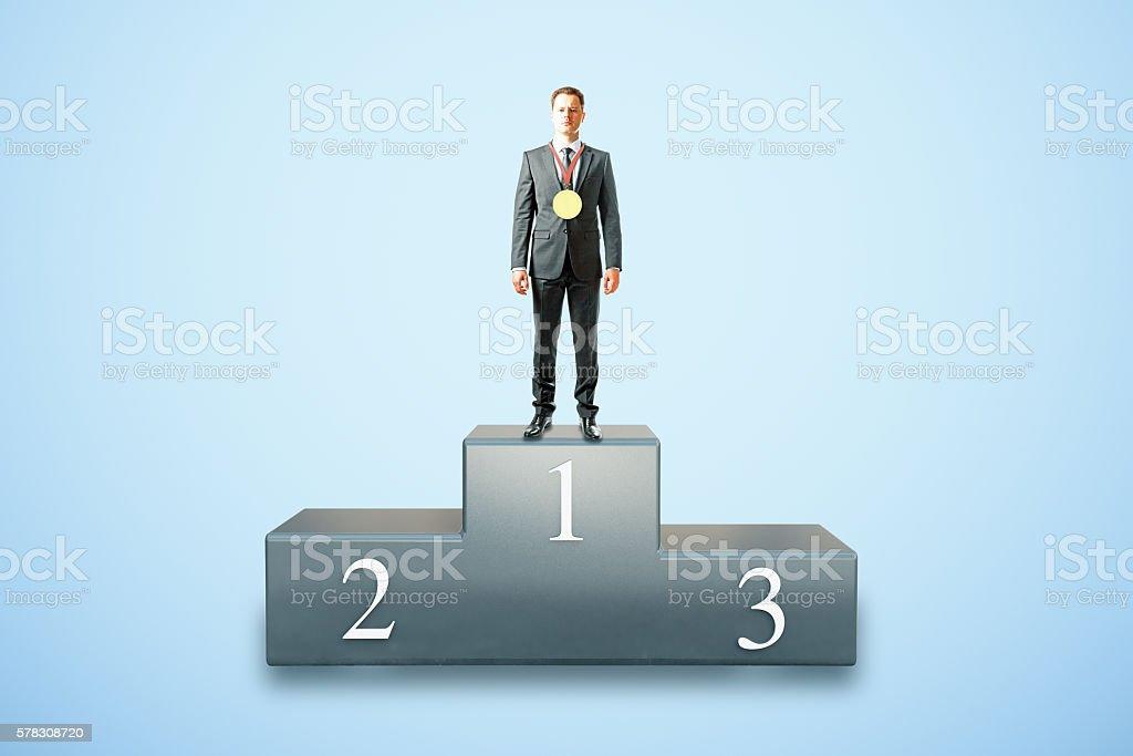 Businessman on pedestal stock photo