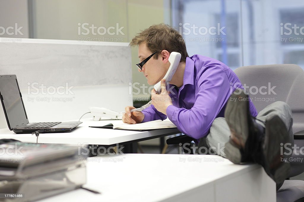 businessman on phone - bad sitting posture stock photo