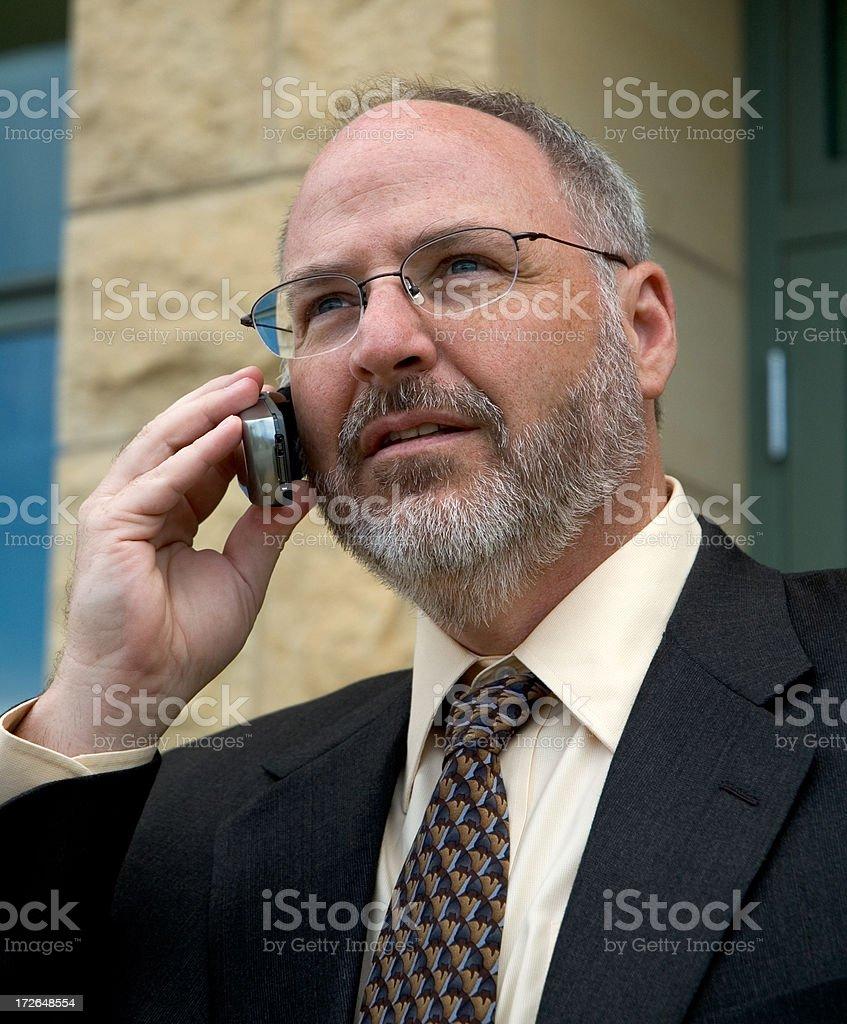 Uomo d'affari al telefono-Primo piano foto stock royalty-free