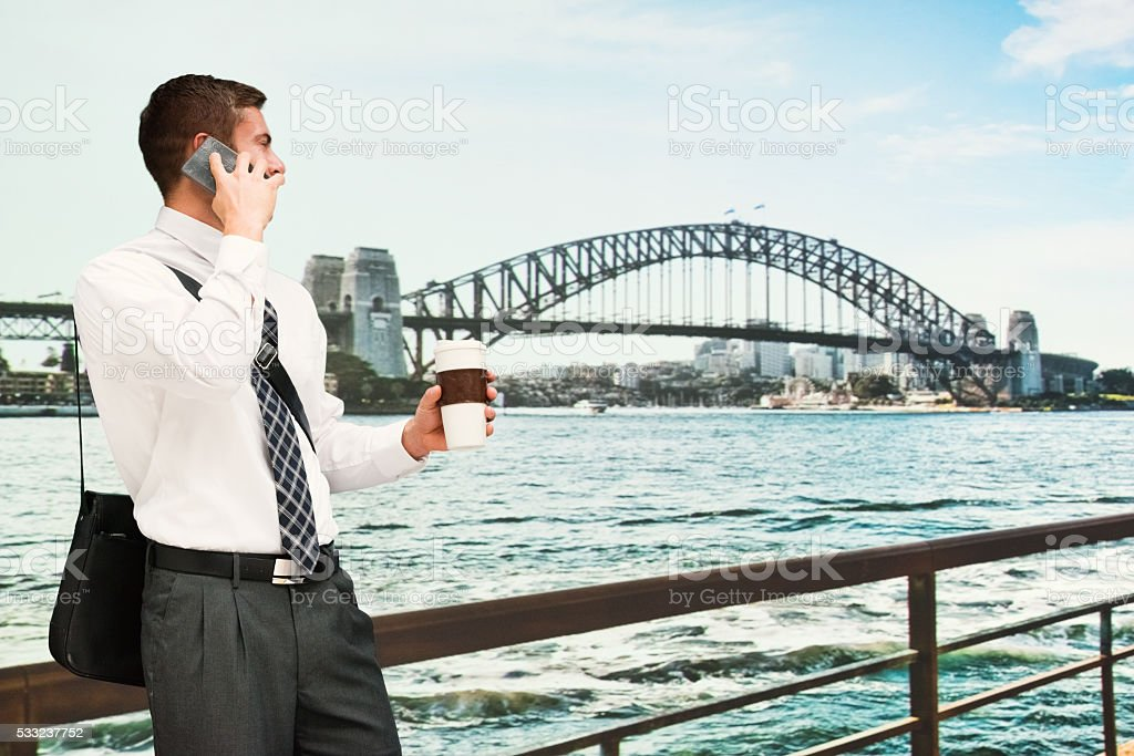 Businessman on phone outdoors stock photo