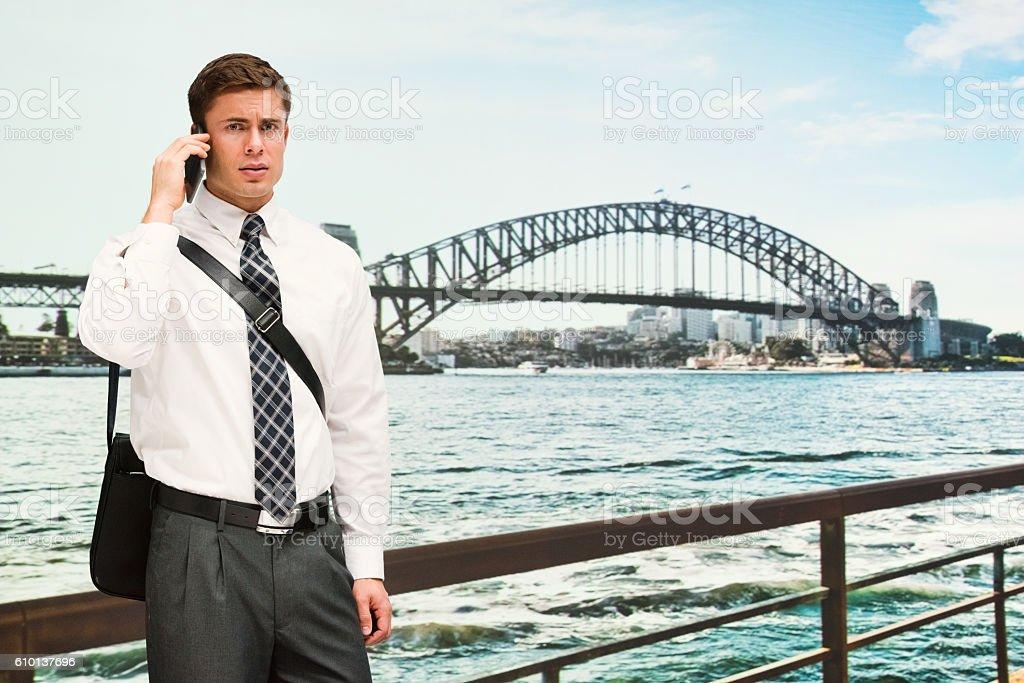 Businessman on phone outdoors stock photo