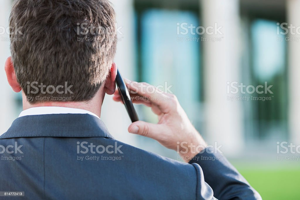 Businessman on phone stock photo
