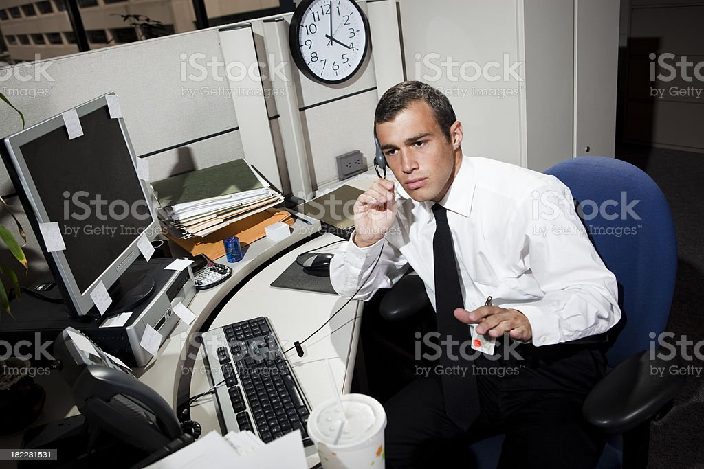 Businessman on Phone Working in Office Cubicle royalty-free stock photo