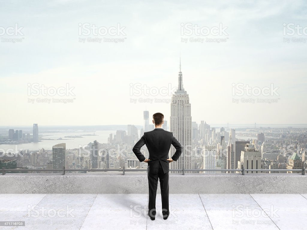businessman on roof royalty-free stock photo