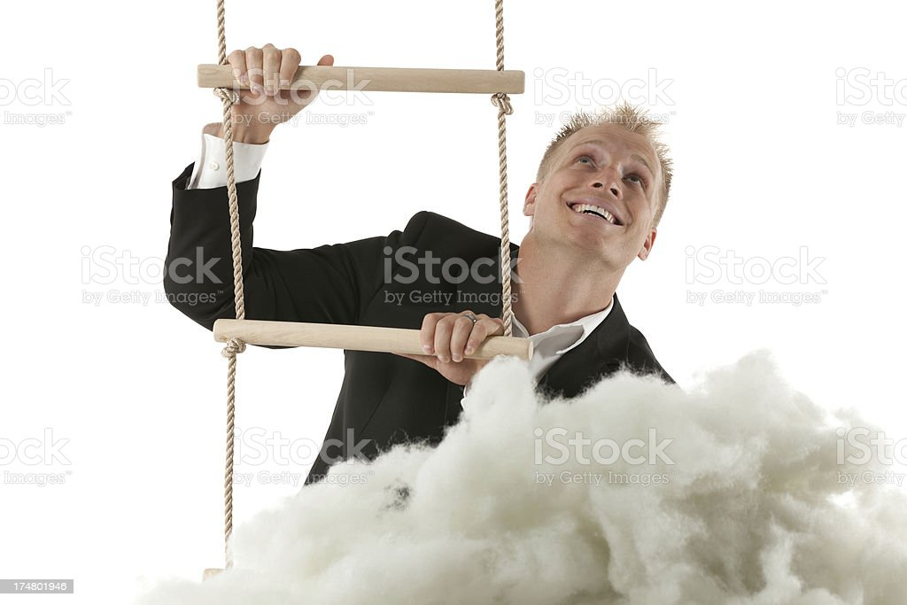 Businessman on rope ladder over the cloud royalty-free stock photo