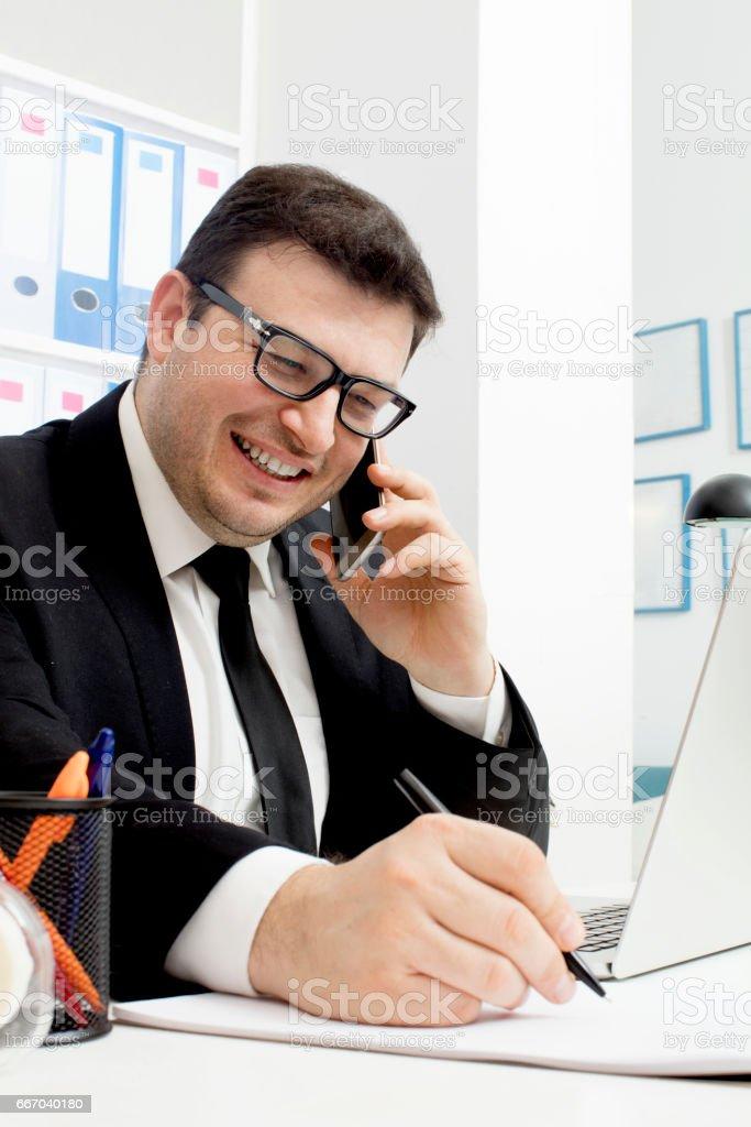 Businessman on smartphone stock photo