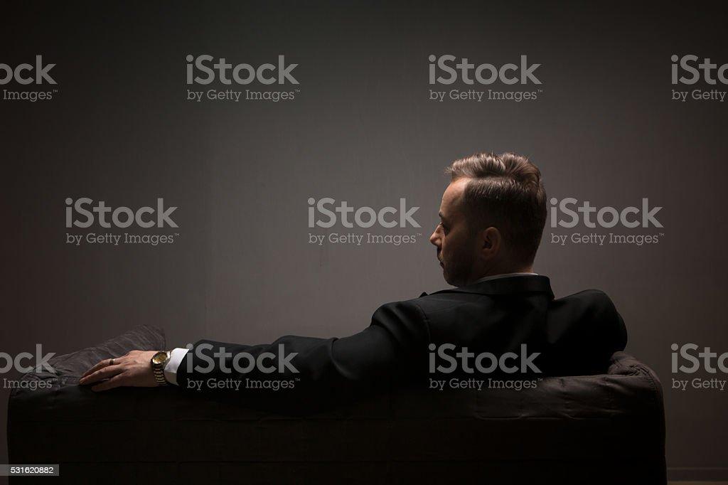 Businessman on sofa stock photo