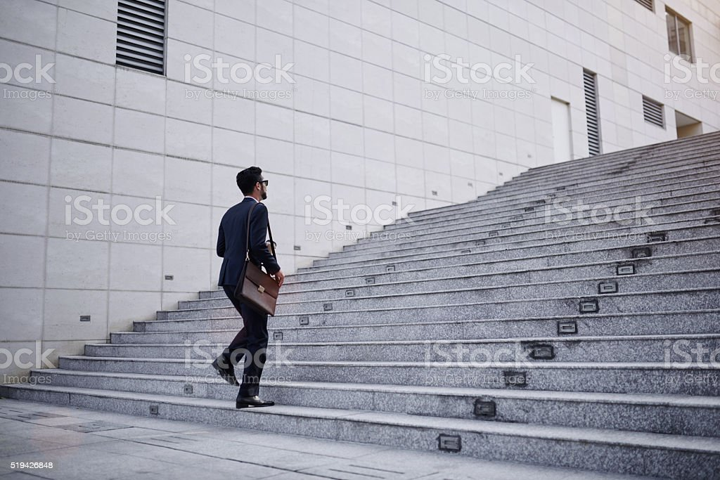 Businessman on stairs stock photo