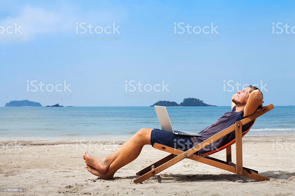 businessman on the beach stock photo
