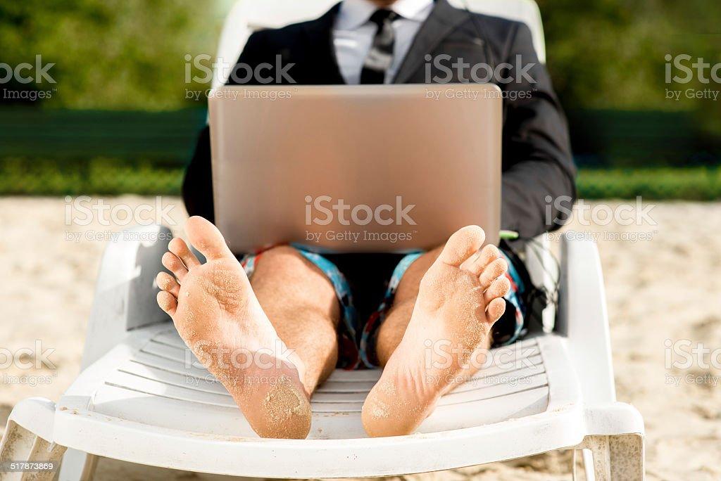 Businessman on the beach stock photo