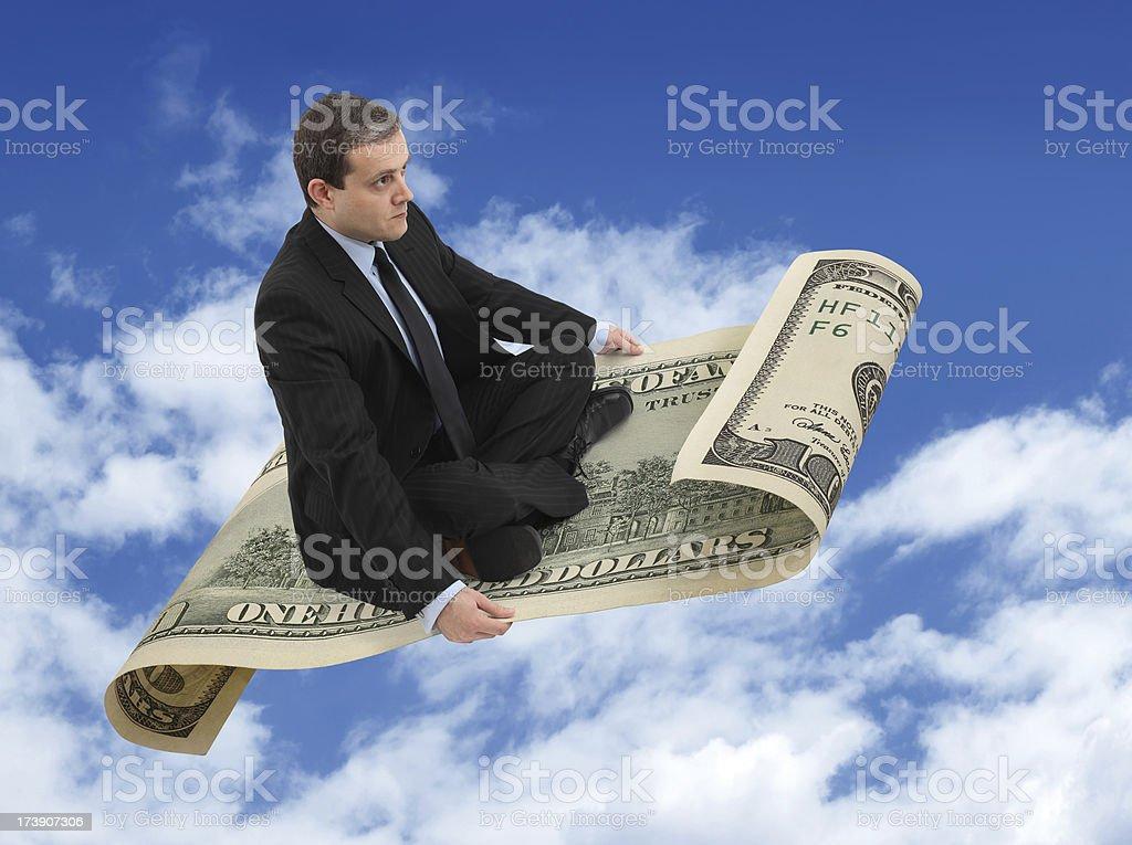 Businessman On The Flying Dollar stock photo