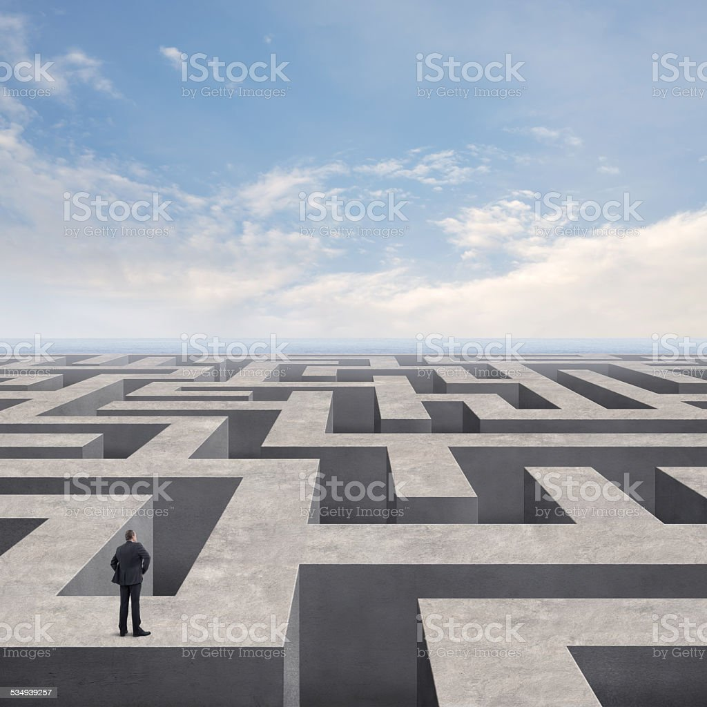 Businessman on the Labyrinth Wall stock photo