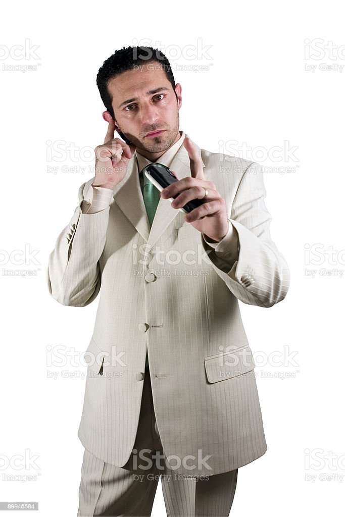 Businessman on the PDA phone with an ear piece royalty-free stock photo