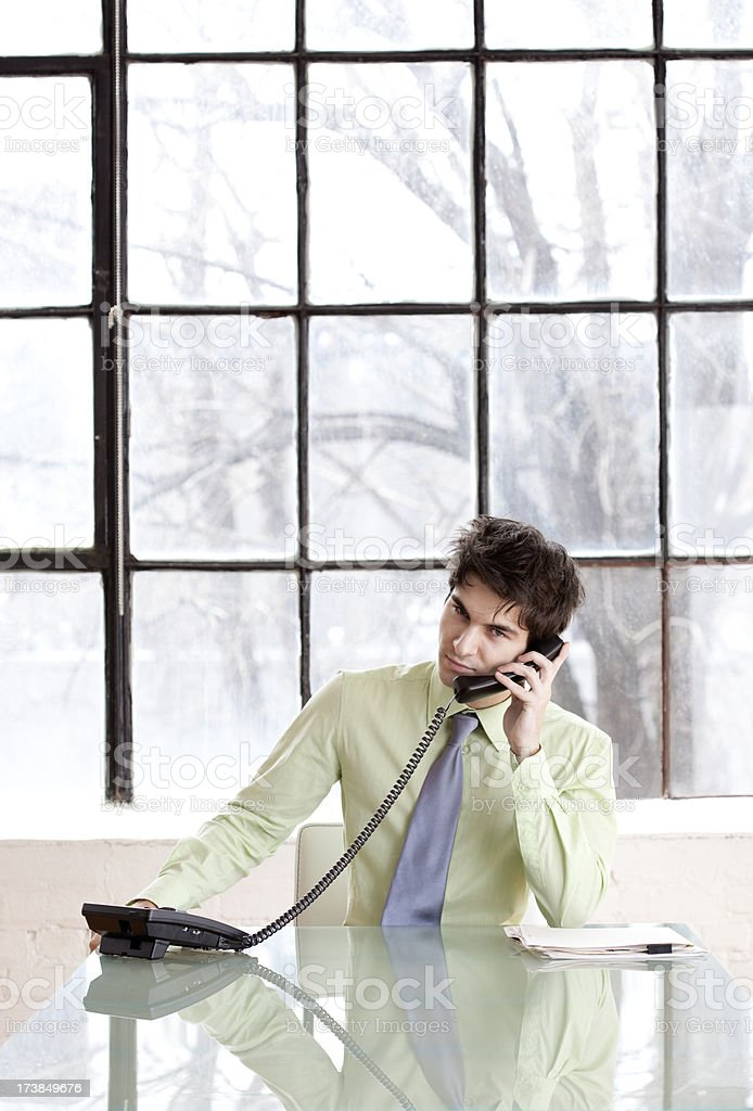 Businessman on the Phone at desk. stock photo
