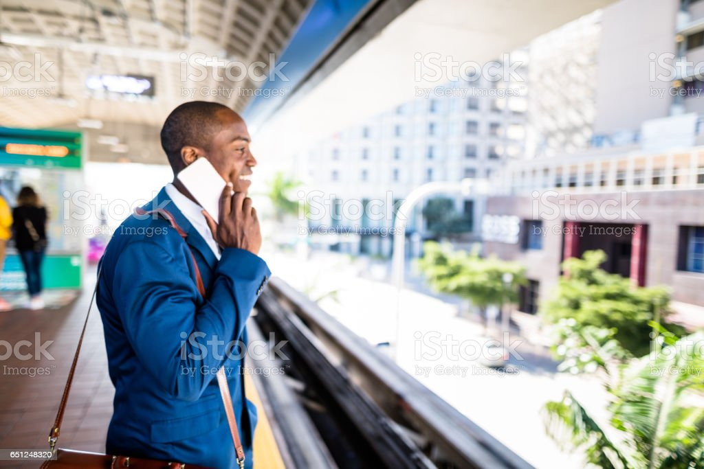 businessman on the phone at the station stock photo
