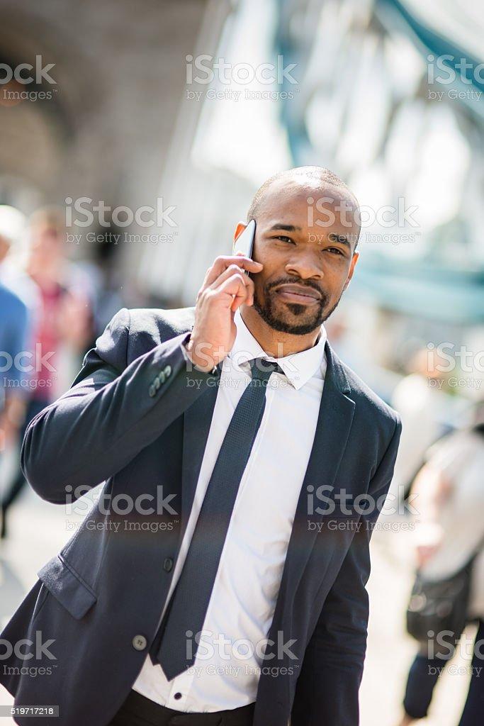 Businessman on the phone happiness on tower bridge stock photo