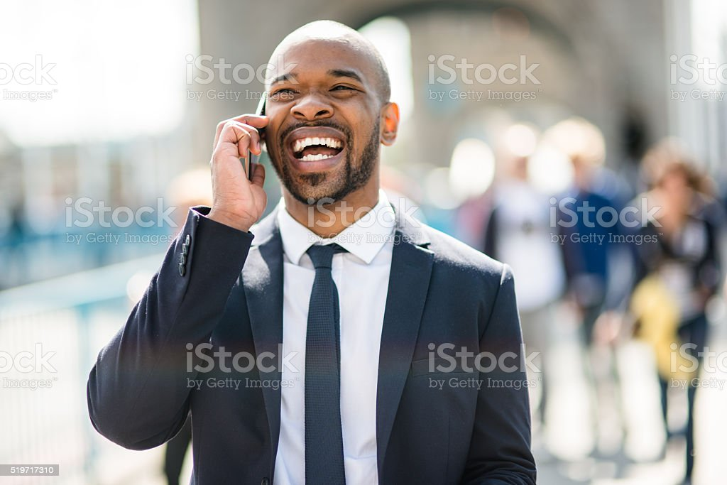 Businessman on the phone happiness on tower bridge stock photo