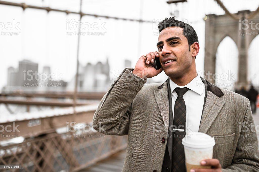 Businessman on the phone in brooklyn bridge stock photo