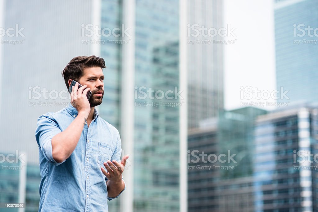 Businessman on the phone in London stock photo