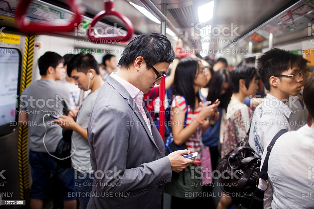 Businessman on the phone in subway train royalty-free stock photo
