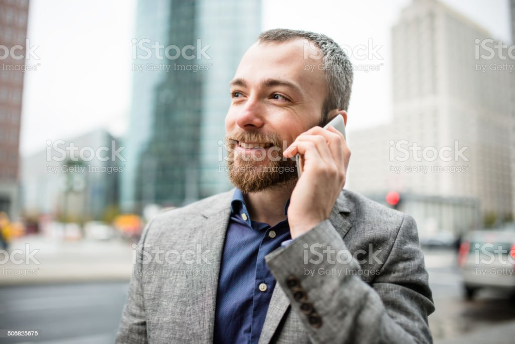 Businessman on the phone in the city stock photo