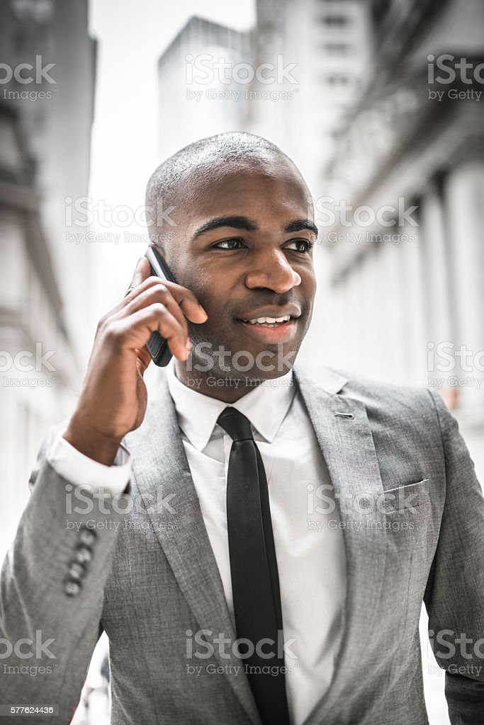 Businessman on the phone in wall street stock photo