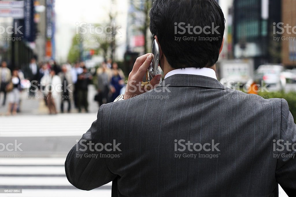 Businessman on the phone on the street stock photo