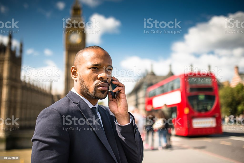 Businessman on the phone on the westminster bridge stock photo