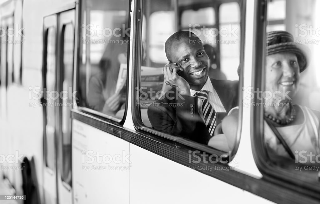 businessman on the way to work by  city bus stock photo