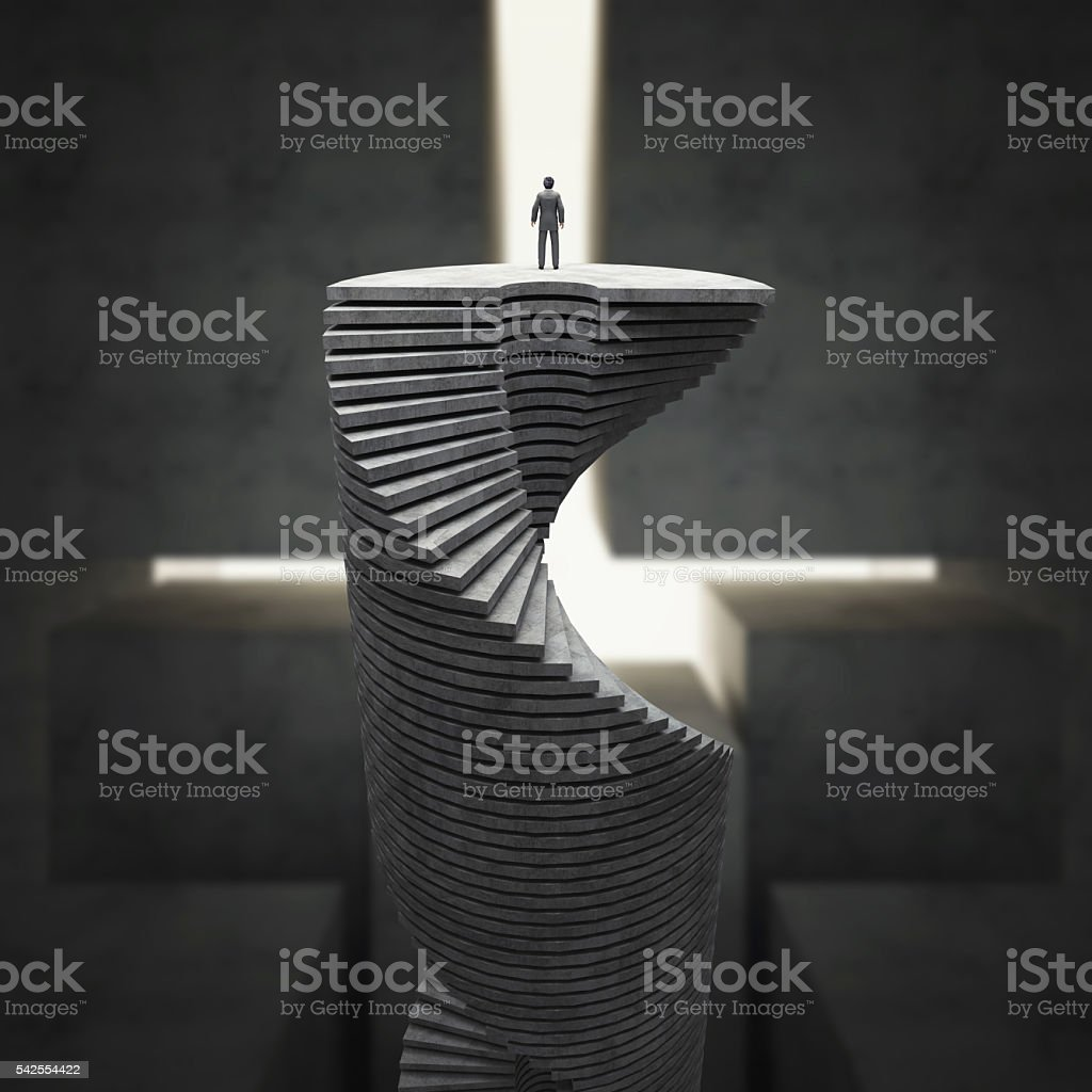 Businessman on top of the stairs stock photo