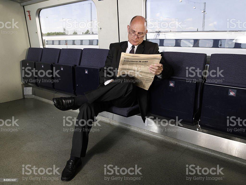 Businessman on train stock photo