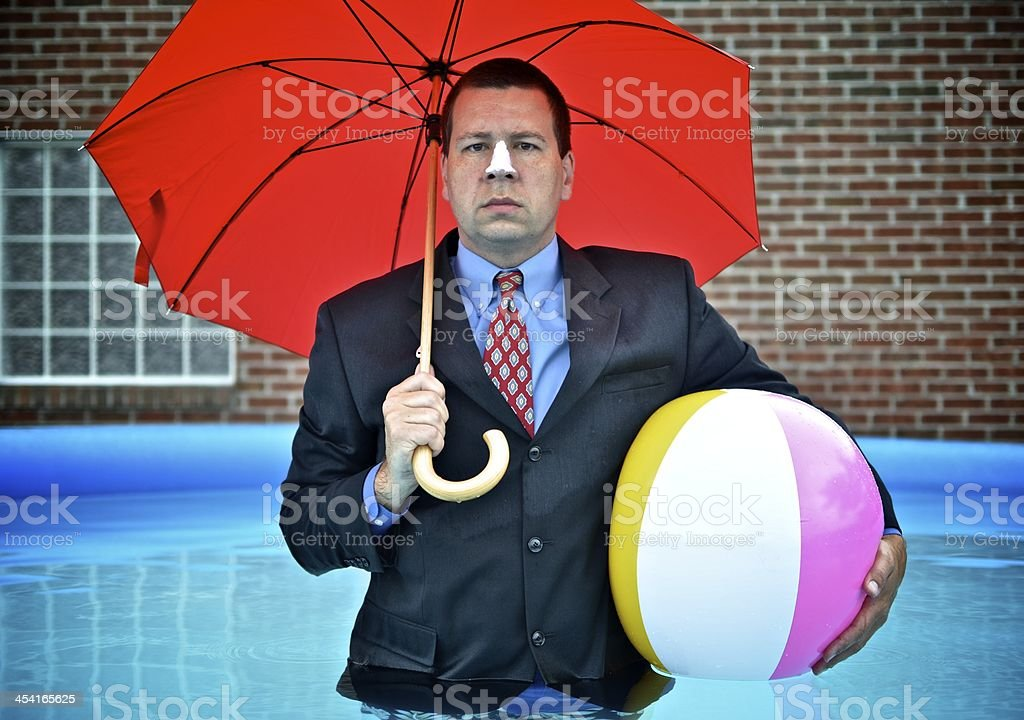 Businessman on Vacation Standing In Pool stock photo