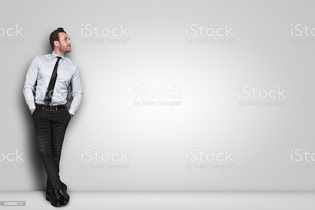 Businessman on white wall stock photo