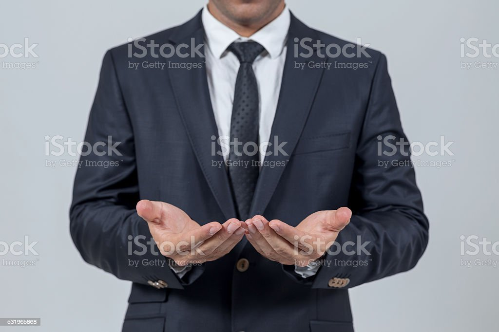 Businessman opening hands stock photo