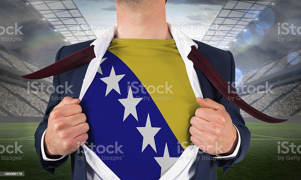 Businessman opening shirt to reveal bosnia flag stock photo