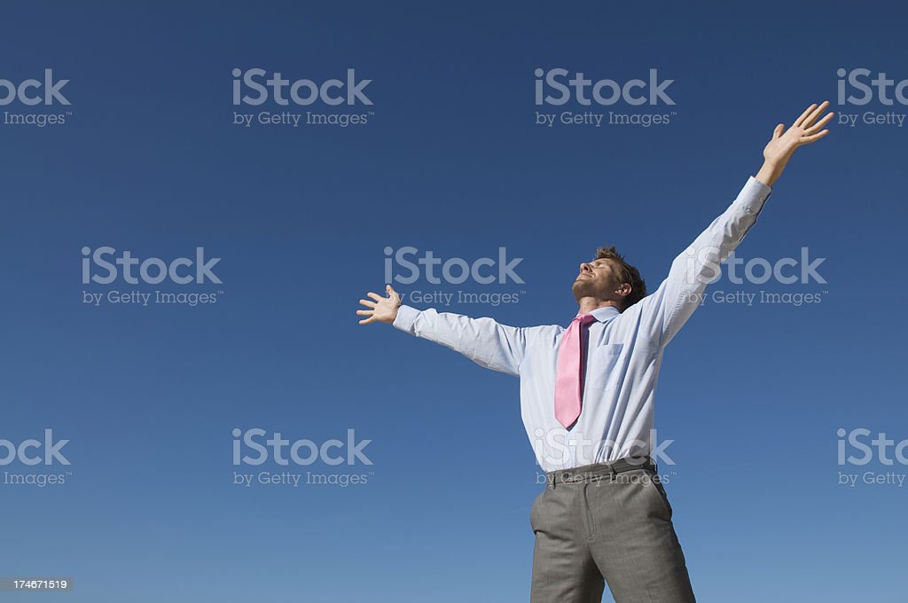 Businessman Opens Arms to Blue Sky for Inspiration royalty-free stock photo