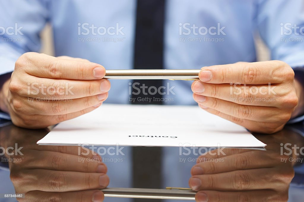 businessman or lawyer is analyzing contract before signing stock photo