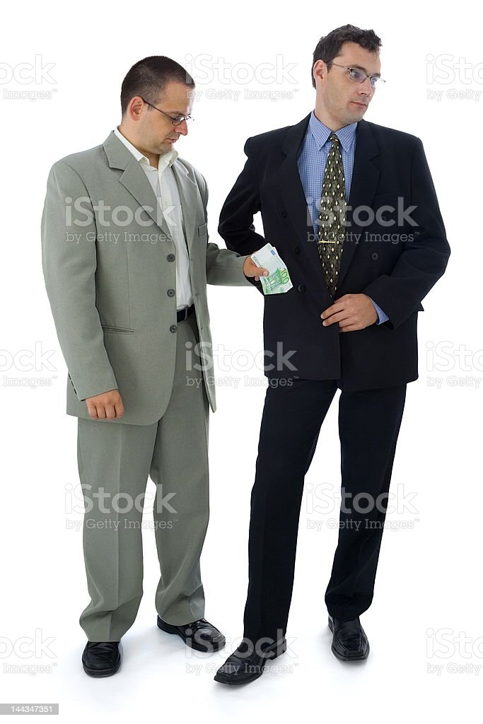 Businessman or politician taking bribe royalty-free stock photo