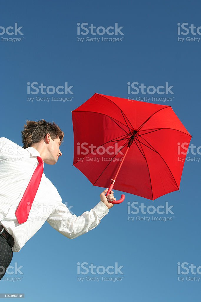 Businessman Outdoors Holding an Umbrella royalty-free stock photo