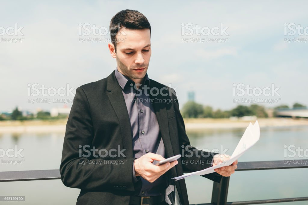 Businessman outdoors stock photo