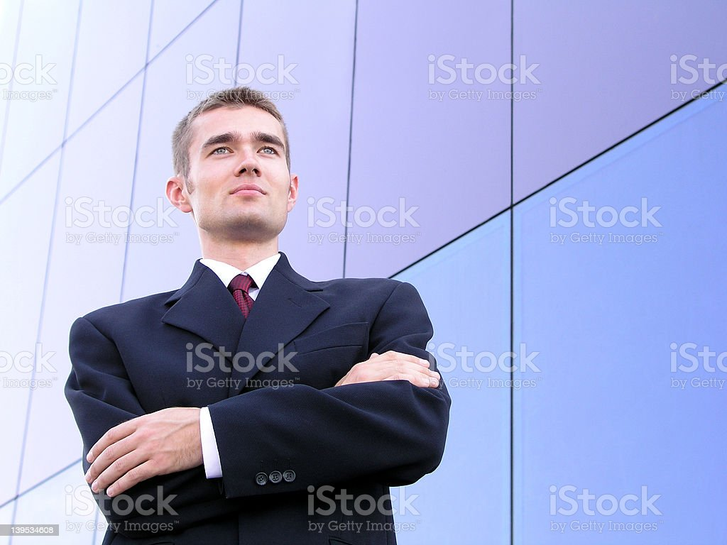 Businessman outside a modern office building royalty-free stock photo