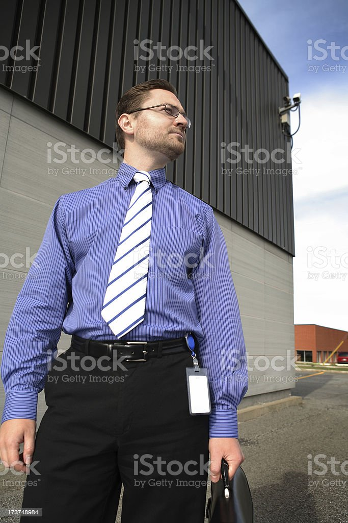 Businessman outside building stock photo